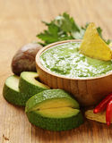 Natural fresh guacamole dip with avocado and chips Stock Photo