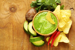 Natural fresh guacamole dip with avocado and chips Royalty Free Stock Photos