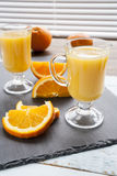 Natural and fresh orange juice in glass cup with fresh orange Stock Photo