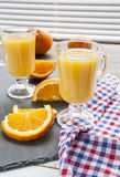 Natural and fresh orange juice in glass cup with fresh orange Royalty Free Stock Photo