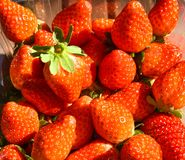 natural and fresh red strawberries on a table ready to eat stock image