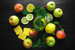 Natural fresh tea in a cup on wooden table with lemon and apples Royalty Free Stock Image