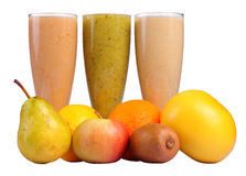 Fruit juice. Natural fruit juice and fruit in the foreground isolated on white Stock Photo