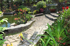Natural garden and pond. Beautiful natural stone path garden with fish pond Stock Image