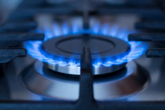 Natural gas. Blue flames of natural gas burning from a gas stove stock image