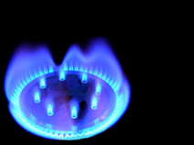 Natural gas, bringing warmly on a black Stock Photos