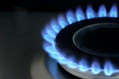 Natural gas burning on kitchen gas stove on black stock photos