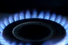 Natural gas burning on kitchen gas stove on black royalty free stock photos