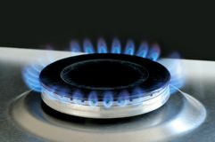 Natural gas burning on kitchen gas stove stock photography