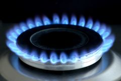 Natural gas burning on kitchen gas stove on black royalty free stock image