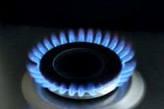 Natural gas burning on kitchen gas stove on black royalty free stock photo
