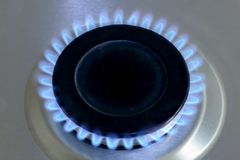 Natural gas burning on kitchen gas stove. View from top royalty free stock photography