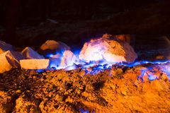 Natural gas burns a flame at night Royalty Free Stock Images