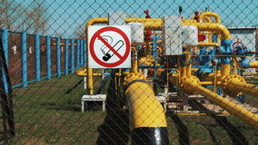 Natural gas. Cleaning and transportation station. Processing of gas and oil. Pipeline with a manometer and a pump. oil. Industry. no smoking. Warning on the stock video footage