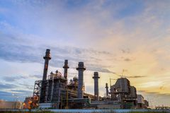 Natural Gas Combined Cycle Power plant electricity generating station. With sunset royalty free stock photos