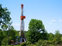 Natural Gas Drill in Dense Forest. This Marcellus Shale natural gas drill is squeezed into a forest in northeast Pennsylvania royalty free stock images