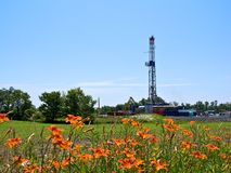 Natural Gas Drill in Farmland. The is a natural gas fracking drill worksite in the middle of rural farmland in Pennsylvania stock photography