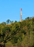 Natural Gas Drill on Mountain Slope. A Marcellus Shale natural gas drill can be seen on a Pennsylvania mountain slope stock images