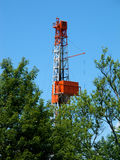 Natural Gas Drill Peaking Above Trees Stock Images