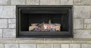 Natural gas energy efficient glowing fireplace stock footage