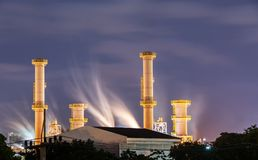 Natural gas factory in night time. Natural Gas storage tanks , gas factory in night time stock photo