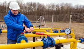 Natural gas field station equipment. ZHYDACHIV, UKRAINE - APRIL 15: Worker employs equipment of the natural gas field station near western ukrainian city Royalty Free Stock Photography