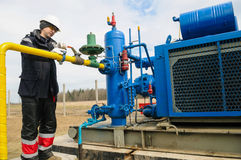 Natural gas field station equipment. ZHYDACHIV, UKRAINE - APRIL 15: Worker employs equipment of the natural gas field station near western ukrainian city Royalty Free Stock Photos