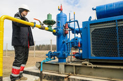 Natural gas field station equipment. ZHYDACHIV, UKRAINE - APRIL 15: Worker employs equipment of the natural gas field station near western ukrainian city Stock Photos