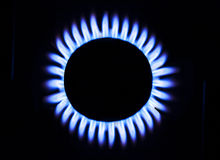 Natural gas flame. Blue flame of gas on a cooker royalty free stock photo