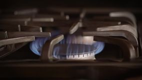 Natural gas flame from kitchen stove burner - Energy and power concept stock footage