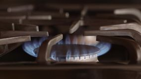 Natural gas flame from kitchen stove burner - Energy and power concept stock video footage