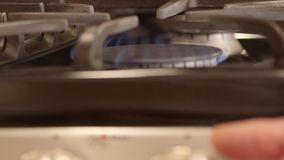 Natural gas flame from kitchen stove burner - Energy and power concept stock video