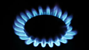 Natural gas inflammation in stove burner Royalty Free Stock Image