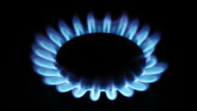 Natural gas inflammation in stove burner Royalty Free Stock Photos