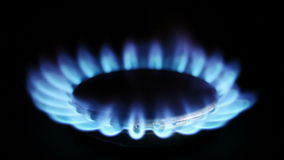 Natural gas inflammation in stove burner Stock Photos