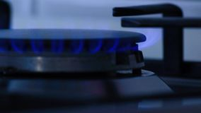 Natural gas inflammation in stove burner, view of gas methane in the kitchen stock footage