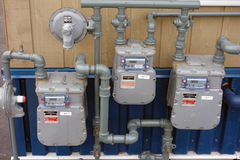 Natural gas meters. An array of individual meters used to distribute natural gas Royalty Free Stock Image