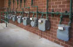 Natural gas meters. Commercial building gas meters close up with shallow depth of field Stock Image