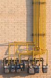 Natural Gas meters maze. Maze of pipes and natural gas meters. Concept for raising energy or utility costs, evironmental concerns or advantages of alternative Stock Photos