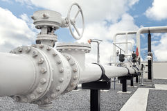 Natural gas processing plant with pipe line valves. With blue sky and clouds Stock Photography