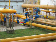 Natural gas station with yellow pipes power plant Royalty Free Stock Image