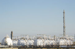 Natural gas storage. Spherical reservoirs containing liquefied natural gas on a refinery platform stock images