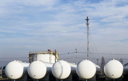 Natural gas storage tanks. New , white natural gas storage tanks ready to be installed stock photography