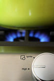 Natural gas stove dial, flame and pot Stock Images