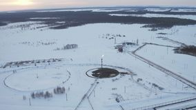 Aerial View Gas burning from flare structure in oilfield Winter stock video