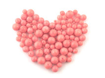Natural gemstone pink coral beads on a white background Royalty Free Stock Images
