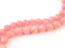 Natural gemstone pink coral beads on a white background.  Royalty Free Stock Photos