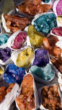 Natural gemstones. Assorted natural gemstones in different colours and each is wrapped in white paper. Photo taken on: October 4th, 2014 during a gemstone Royalty Free Stock Image