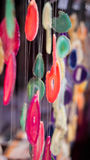 Natural gemstones wind chimes. Wind chimes made up of natural gemstones sliced thin and tied together with nylon strings. Photo taken on: October 4th, 2014 Royalty Free Stock Image