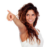 Natural girl with curly hair indicating something. Isolated on a white background stock images